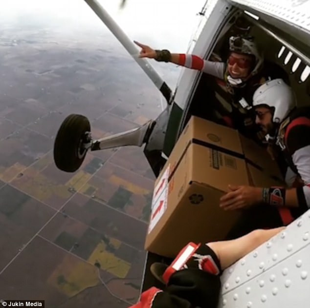 Skydivers with box
